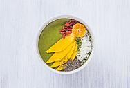 Bowl of green smoothie with topping - KNTF000202
