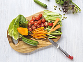 Chopped vegetables on wooden board - KNTF000211