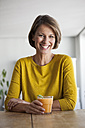 Portrait of smiling woman with a smoothie - RBF003629