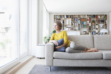 Relaxed woman at home on couch - RBF003632