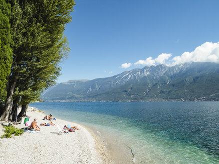 Italy, Lake Garda, People sunbathing at beach near Porto di Tignale - GS001054