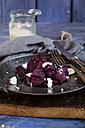 Metal plate of beetroot salad with feta and sea salt - SBDF002582