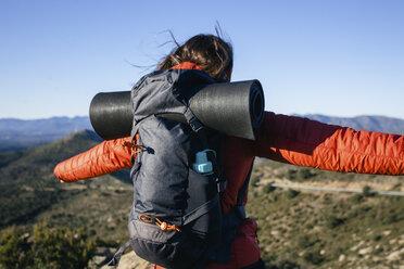 Spain, Catalunya, Girona, female hiker enjoying the nature - EBSF001158