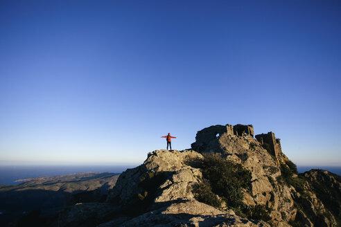 Spain, Catalunya, Girona, female hiker on mountaintop enjoying the nature - EBSF001164