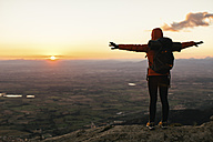 Spain, Catalunya, Girona, female hiker in the nature looking at view at sunrise - EBSF001170