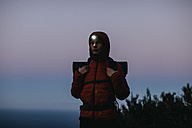 Spain, Catalunya, Girona, female hiker wearing headlamp at twilight - EBSF001173