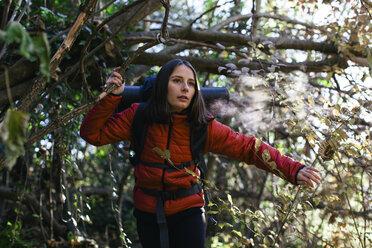 Spain, Catalunya, Girona, female hiker walking in the woods - EBSF001191