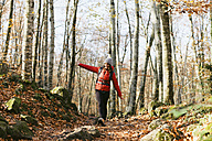 Spain, Catalunya, Girona, female hiker walking in the woods - EBSF001197