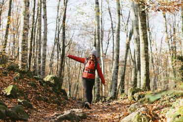 Spain, Catalunya, Girona, female hiker walking in the woods - EBSF001197