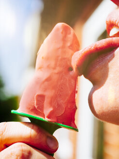 Woman eating homemade strawberry ice cream, close-up - KRPF001684