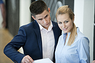 Businessman and businesswoman in office - WESTF021627