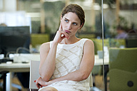 Businesswoman in office thinking - WESTF021636