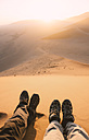 Namibia, Namib Desert, Sossusvlei. Couple enjoying the sunrise from the Dune 45 - GEMF000554