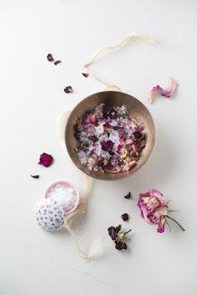Bowl of bath salts and dried rose petals - MYF001275