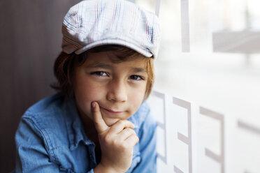 Portrait of serious looking little boy wearing cap - VABF000011
