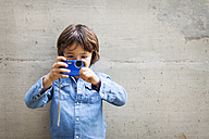 Little boy taking a picture with digital camera - VABF000023