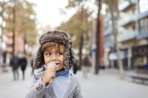 Portrait of happy little boy with ice cream cone on the street - VABF000032
