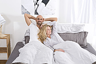 Happy couple lyining in bed - MAEF011115