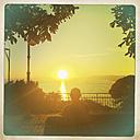 Italy, Liguria, Ruta, Mediterranean Sea at sunset - GWF004546
