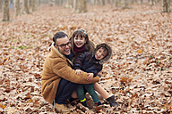 Father with happy children in park, autumn - XCF000048