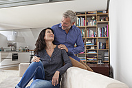 Smiling mature couple at home - RBF003636