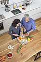 Mature couple preparing vegetables in kitchen - RBF003732
