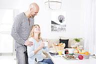 Happy couple at the breakfast table - MAEF011151