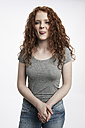 Portrait of redheaded teenage girl sticking out tongue - GDF000940
