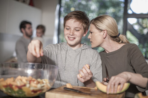 Mother and son in kitchen preparing food - ZEF007693