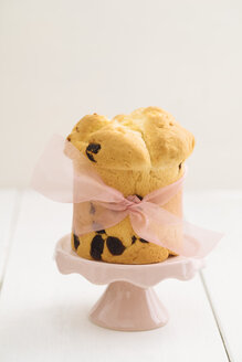Home-baked mini panettone on pink cake stand - ECF001838