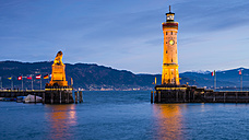 Germany, Bavaria, Lindau, Lake Constance, Harbour entrance with bavarian lion in the evening - WGF000798