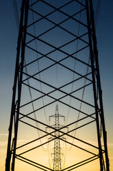 Austria, Braunau am Inn District, power pylons in the evening - OPF000097