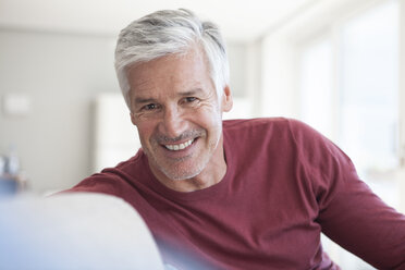 Portrait of smiling mature man with  grey hair and stubble - RBF003804
