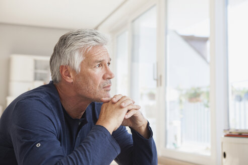 Portrait of pensive man at home - RBF003825
