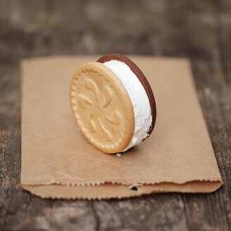 Ice cream cookie sandwich stands on paper bag - LSF000073