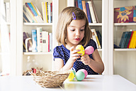 Little girl playing with Easter eggs - LVF004337