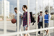 Young men on basketball court - UUF006280
