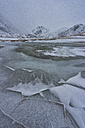Norway, Lofoten, frozen lake in winter - LOMF000169