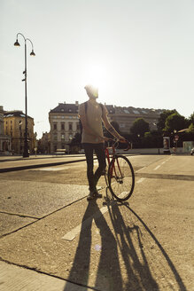 Young man with racing cycle in Vienna, bicycle lane, Dr.-Karl-Renner-Ring - AIF000136
