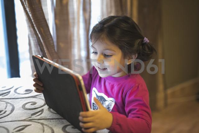 Little girl using digital tablet at home - JASF000333