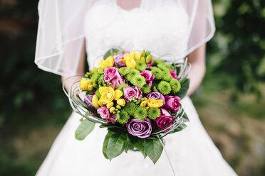 Bride holding her bouquet - DAW000432
