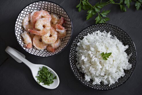 Bowls of long grain rice with parsley and shrimps - YFF000501