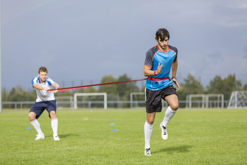 Two soccer players exercising on sports field - SHKF000395