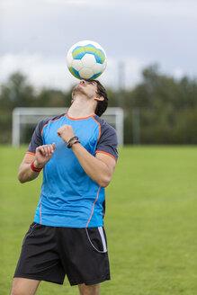 Soccer player balancing ball on head - SHKF000398