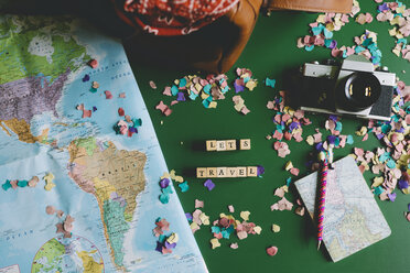 Map next to a camera, a travel bag and a notebook with a funny llama pen - GEM000594