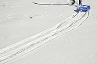 Spain, La Molina, man with plastic sledge - SKCF000039