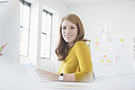 Young woman in office working at desk - RBF003939