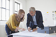 Two architects discussing project in office - RBF003966