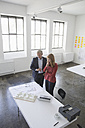 Two architects discussing project in office - RBF003981