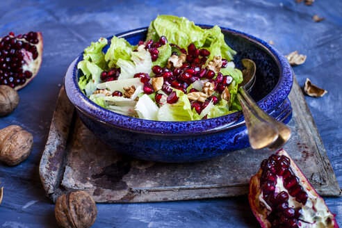 Bowl of Romaine lettuce with walnuts, pomegranate dressing and seed - SBDF002620